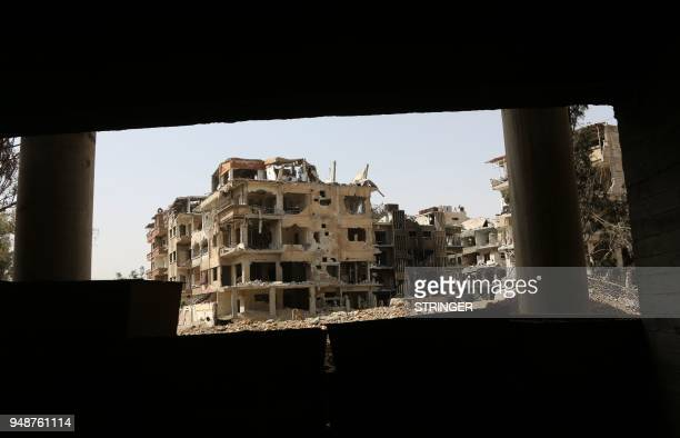 A general view shows destroyed buildings in the former rebelheld Syrian town of Douma on the outskirts of Damascus on April 19 five days after the...
