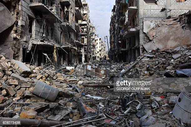 TOPSHOT A general view shows destruction in the alShaar neighbourhood after government forces took control of the area in the eastern part of the...