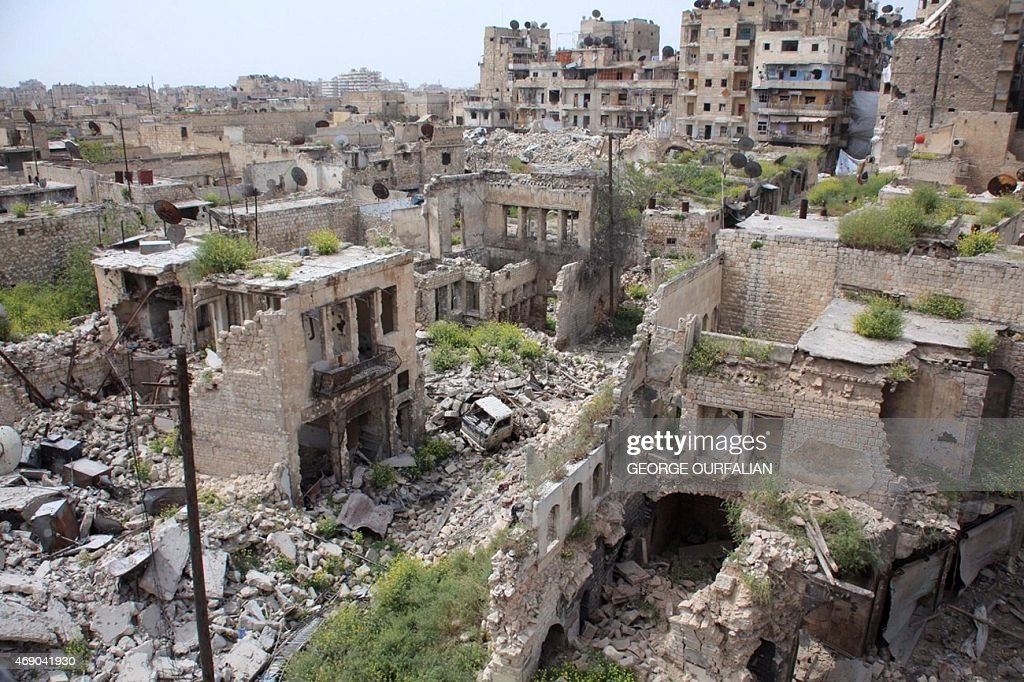A general view shows destruction in the Hamidiyeh neighbourhood of the northern Syrian city of Aleppo as local popular committee fighters, who support the Syrian government forces, try to defend the traditionally Christian district on the third day of intense battles with Islamic State group jihadists on April 9, 2015.