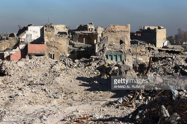 A general view shows destruction in the old city of Mosul on January 9 2018 Along the waterfront of the Tigris River in Iraq's wartorn Mosul gaping...