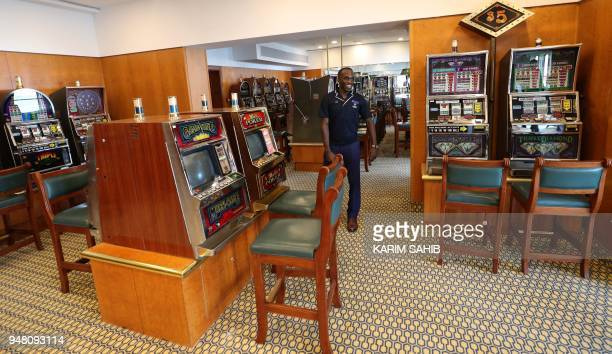 A general view shows disused slot machines in the gaming arcade of The Queen Elizabeth II luxury cruise liner also known as the QE2 docked at Port...
