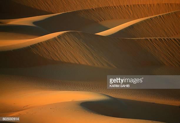 A general view shows dunes in the Liwa Oasis southwest of the Emirati capital Abu Dhabi on December 20 2015 AFP PHOTO/KARIM SAHIB / AFP / KARIM SAHIB