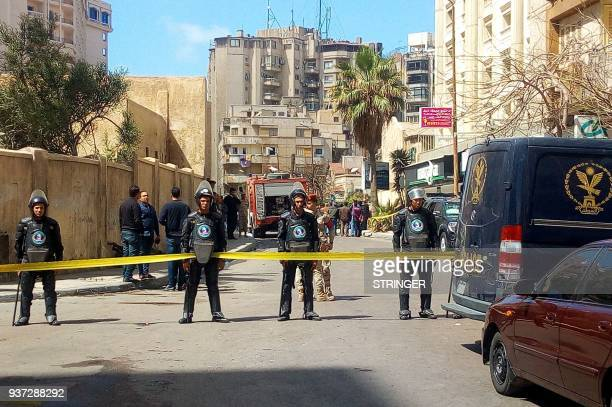 A general view shows Egyptian riot police cordoning off the street at the site of a bomb attack in the northern port city of Alexandria which hit a...