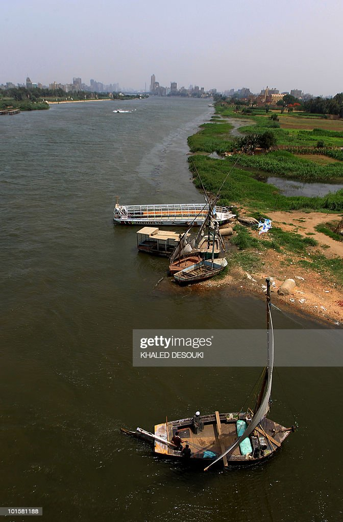 A general view shows Egyptian sailboats, known as falukas, and a small ferryboat (back) used by locals to cross from one side of the River Nile to the other on the outskirts of Cairo on May 18, 2010. Four African countries signed on May 14 a new treaty on the equitable sharing of the Nile waters despite strong opposition from Egypt and Sudan who have the lion's share of the river waters.