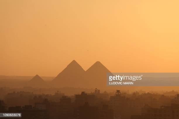 A general view shows Egypt's Giza Pyramids on the outskirts of Cairo during sunset on January 28 2019