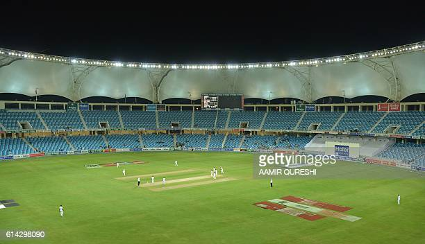 A general view shows empty enclosures on the opening day of the first daynight Test between Pakistan and the West Indies at the Dubai International...