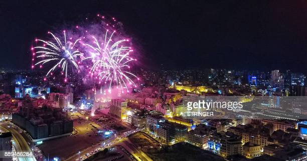 A general view shows fireworks above the Mohammad alAmin mosque during an event to turn on the lights of a Christmas tree in downtown Beirut on...