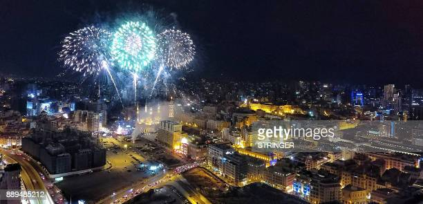 A general view shows fireworks next to the Mohammad alAmin mosque during an event to turn on the lights of a Christmas tree in downtown Beirut on...