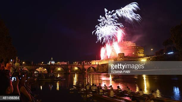 A general view shows fireworks over the Tiber river and the Castel Sant'Angelo during the traditional 'Girandola' the feast of Romes patron St Peter...