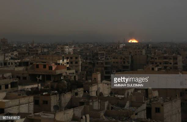 A general view shows flames rising from buildings following reported Syrian government bombardments on rebelheld town of Hamouria in the besieged...