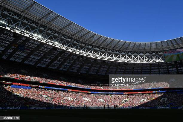 TOPSHOT A general view shows football fans in the grandstand during the Russia 2018 World Cup round of 16 football match between Spain and Russia at...