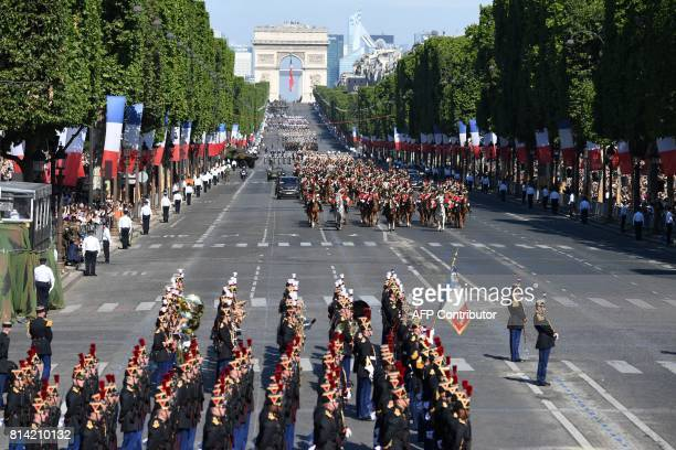 TOPSHOT A general view shows French President Emmanuel Macron and Chief of the Defence Staff of the French Army General Pierre de Villiers escorted...