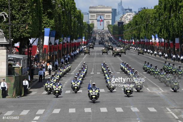 A general view shows French riot police parading during the annual Bastille Day military parade on the ChampsElysees avenue in Paris on July 14 2017...