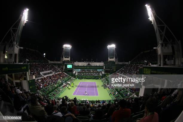 General view shows Gael Monfils of France playing Rafael Nadal of Spain during their Qatar ATP Open Tennis tournament semifinal match at the Khalifa...