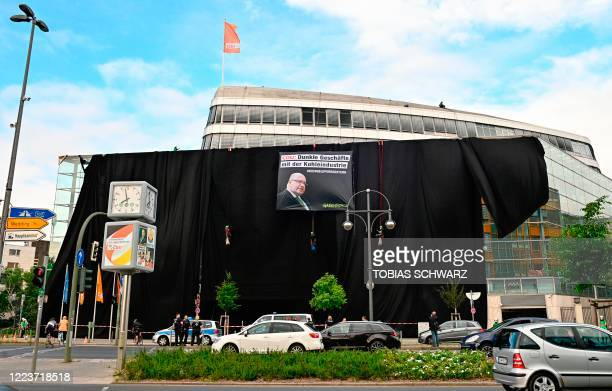 General view shows Greenpeace activists entirely wrapping the party headquarters of the Christian Democratic Union with black fabric and attaching a...