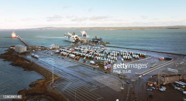 General view shows Irish ferries ro-ro ferry Ulysses unloads as Stena Adventurer arrives in Holyhead port in Anglesey, north Wales on January 02,...