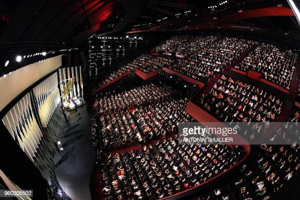 TOPSHOT A general view shows Japanese director Hirokazu KoreEda delivering a speech on stage next to a translator Australian actress and President of...