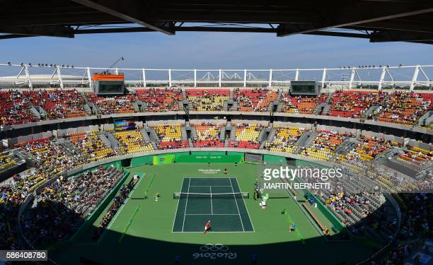 TOPSHOT A general view shows Japan's Kei Nishikori serving the ball to Spain's Alberto RamosVinolas during their men's first round singles tennis...