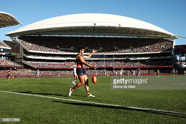 General view shows Kyle Hartigan of the Crows kicking the ball during the round six AFL match between the Adelaide Crows and the Fremantle Dockers at...