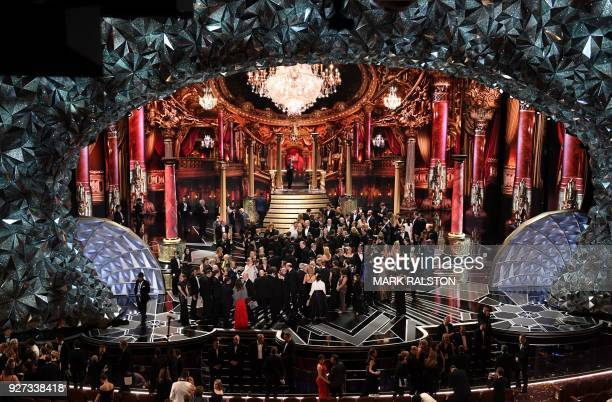 A general view shows laureates and casts on stage at the end of the 90th Annual Academy Awards show on March 4 2018 in Hollywood California / AFP...
