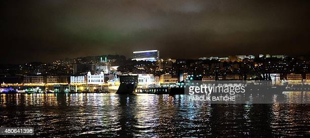 A general view shows lights illuminating the city of Algiers near the jetty during the Muslim holy fasting month of Ramadan on July 13 2015 During...