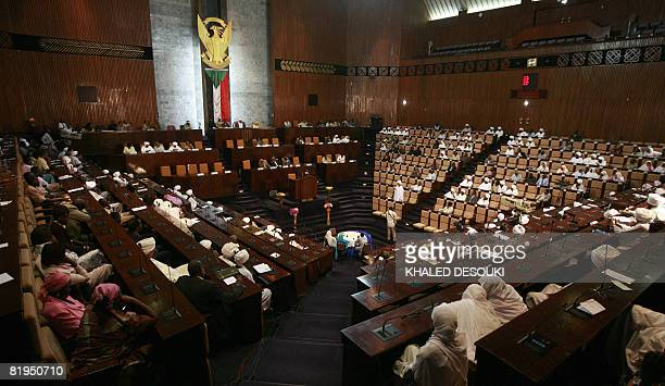 A general view shows members of the Sudanese National Assembly holding an emergency meeting in Khartoum on July 16 2008 to discuss the International...