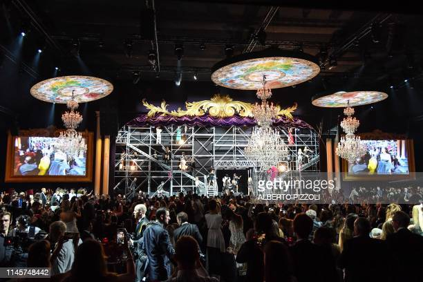 A general view shows models dancing on May 23 2019 during the amfAR 26th Annual Cinema Against AIDS gala at the Hotel du CapEdenRoc in Cap d'Antibes...