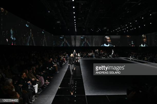 A general view shows models presening creations for Emporio Armani's Women Fall Winter 2020 fashion collection on February 21 2020 in Milan