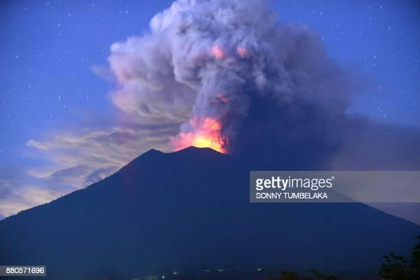 A general view shows Mount Agung erupting seen at night from Kubu subdistrict in Karangasem Regency on Indonesia's resort island of Bali on November...
