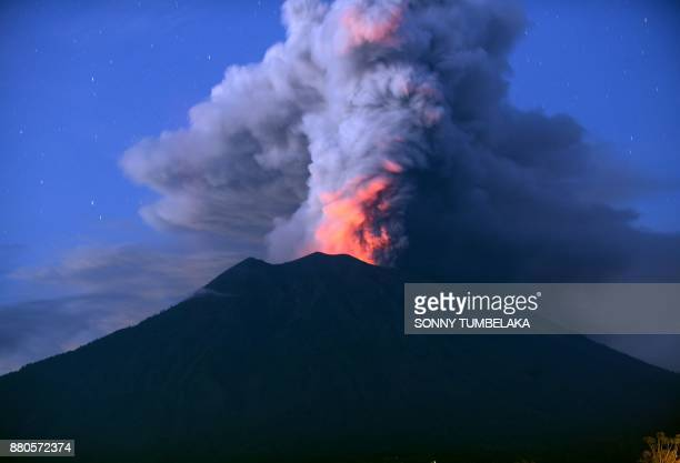 TOPSHOT A general view shows Mount Agung erupting seen at night from Kubu subdistrict in Karangasem Regency on Indonesia's resort island of Bali on...
