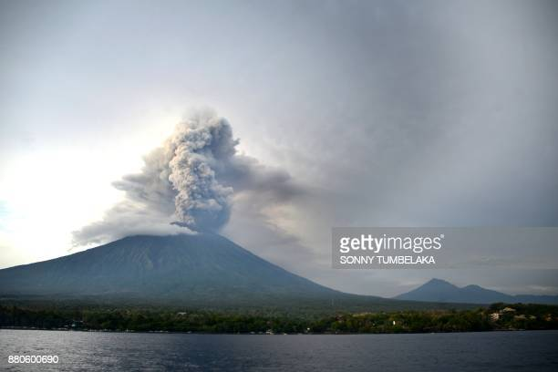 A general view shows Mount Agung erupting seen from Kubu subdistrict in Karangasem Regency on Indonesia's resort island of Bali on November 28 2017...