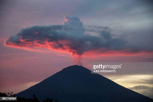 TOPSHOT A general view shows Mount Agung from Amed beach in Karangasem on Indonesia's resort island of Bali on November 30 2017 Thousands of foreign...