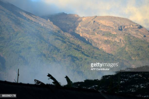 A general view shows Mount Agung from Karangasem on the Indonesian resort island of Bali on September 21 2017 Authorities have raised alert levels...