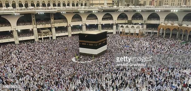 TOPSHOT A general view shows Muslim pilgrims circling the Kaaba Islam's holiest shrine at the Grand Mosque in Saudi Arabia's holy city of Mecca on...