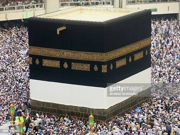 A general view shows Muslim pilgrims circling the Kaaba Islam's holiest shrine at the Grand Mosque in Saudi Arabia's holy city of Mecca on September...