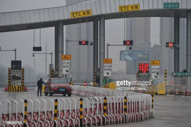 A general view shows one of the roads blocked by the police to restrict people leaving Wuhan in China's central Hubei province on January 25 during a...
