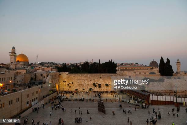 A general view shows Orthodox Jewish men and women gathering at the Western Wall in Jerusalem's Old City between the AlAqsa mosque and the Dome of...