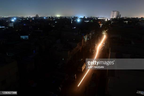 General view shows Pakistan's port city of Karachi during a power blackout early on January 10, 2021.