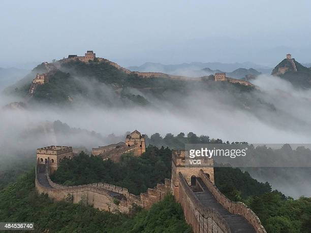 A general view shows part of the Jinshanling section of the Great Wall with cloud around on August 20 2015 in Chengde Hebei Province of China