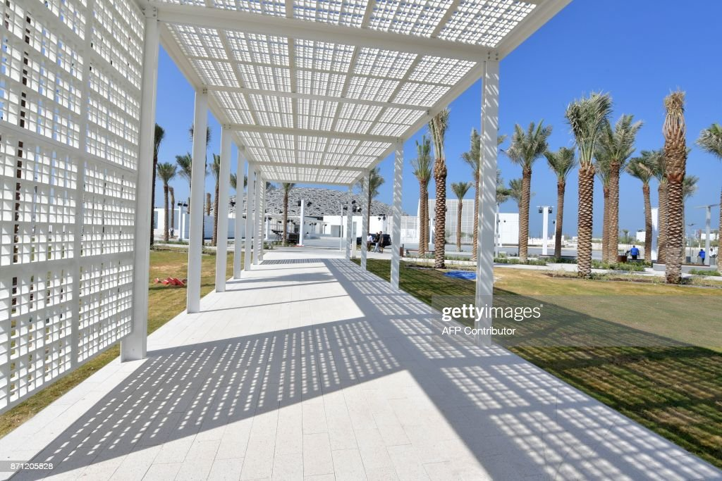 A general view shows part of the Louvre Abu Dhabi Museum designed by French architect Jean Nouvel on November 7, 2017 on the eve of the official opening of the museum on Saadiyat island in the Emirati capital. More than a decade in the making, the Louvre Abu Dhabi opens its doors this week, bringing the famed name to the Arab world for the first time. The museum currently has some 300 pieces on loan, including an 1887 self-portrait by Vincent van Gogh and Leonardo da Vinci's 'La Belle Ferronniere'. CAPTION