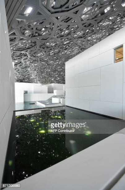 General view shows part of the Louvre Abu Dhabi Museum designed by French architect Jean Nouvel on November 7, 2017 on the eve of the official...