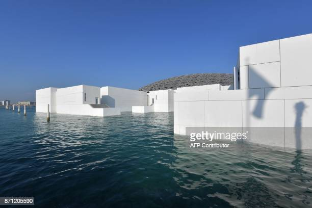 A general view shows part of the Louvre Abu Dhabi Museum designed by French architect Jean Nouvel on November 7 2017 on the eve of the official...