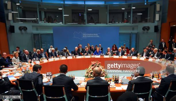 A general view shows participants attending the Peace summit on Libya at the Chancellery in Berlin on January 19 2020 World leaders gather in Berlin...