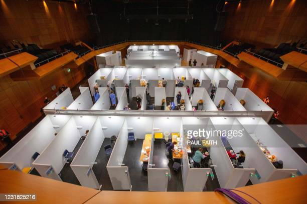 General view shows patients being vaccinated with the Pfizer/BioNTech Covid-19 vaccine at a vaccination centre at the Helix on Dublin City...