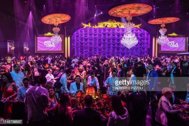 TOPSHOT A general view shows people attending on May 23 2019 the amfAR 26th Annual Cinema Against AIDS gala at the Hotel du CapEdenRoc in Cap...
