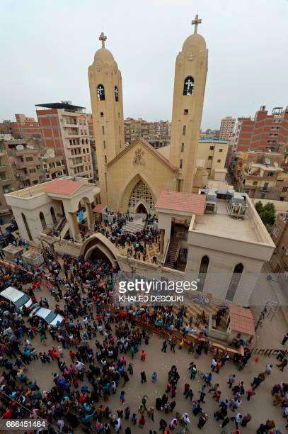A general view shows people gathering outside the Mar Girgis Coptic Church in the Nile Delta City of Tanta 120 kilometres north of Cairo after a bomb...