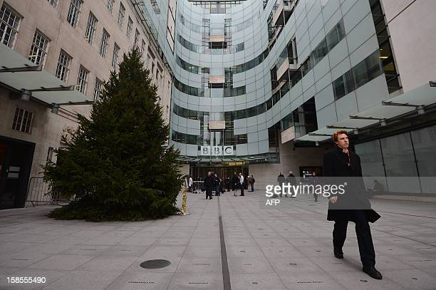 A general view shows people walking outside BBC Broadcasting House in London on December 19 2012 where a press conference will be held later in the...