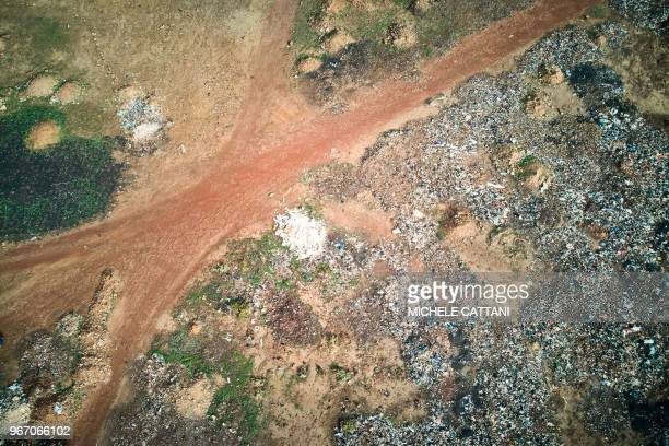 A general view shows plastic waste and other polluting materials at a dump site in Bamako on June 2 2018 On June 5 2018 the United Nations mark the...