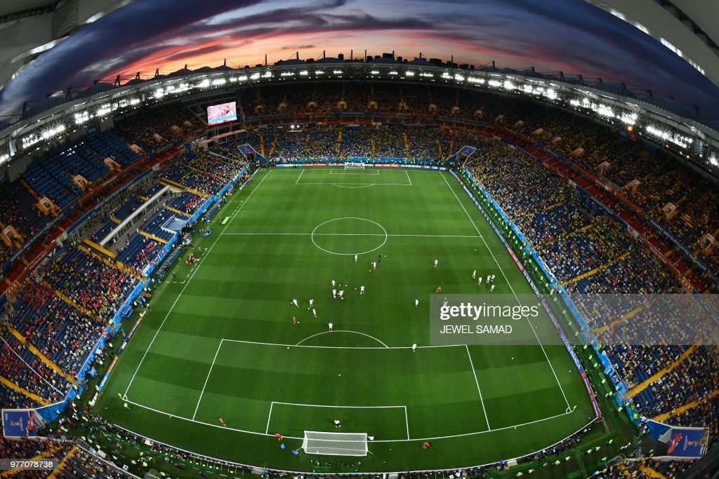 A general view shows players on the pitch at sunset before the Russia 2018 World Cup Group E football match between Brazil and Switzerland at the Rostov Arena in Rostov-On-Don on June 17, 2018. (Photo by Jewel SAMAD / AFP) / RESTRICTED