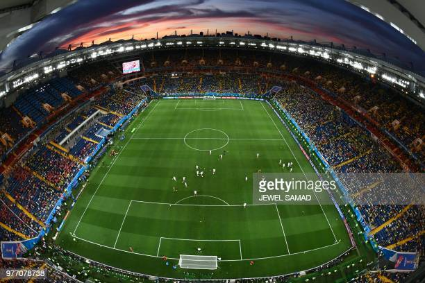 A general view shows players on the pitch at sunset before the Russia 2018 World Cup Group E football match between Brazil and Switzerland at the...
